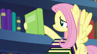 Fluttershy takes another book off the shelf S7E20
