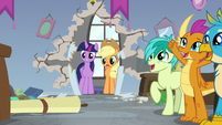 Twilight and AJ surprised; students cheering S8E21