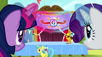 Twilight and Rarity levitating a banner S4E12