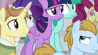 Twilight and Rarity walk through the crowd S8E16