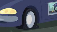 Cranky's testing car with a flat tire CYOE5b