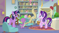 Spike unrolling a large scroll S9E20