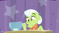 Granny Smith picks up two pieces of paper S9E16