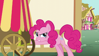 Pinkie Pie trying to get something out of the delivery cart S5E19