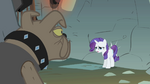 Rarity being moved to a wall behind her S1E19