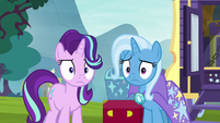Starlight and Trixie stare at Twilight and Cadance S8E19