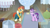 Sunburst gesturing at the chandeliers S7E24