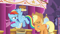 Applejack blows her nose with Dash's tail S5E7