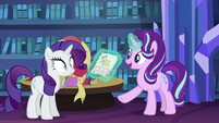 Starlight shows Rarity a picture of a dress S6E21