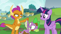 Smolder pointing at Spike's wings S8E24