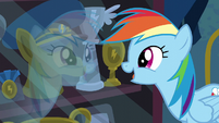 Rainbow marvels at the trophy display S6E7