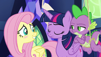 Twilight and Spike in disapproval; Fluttershy blushing S6E11