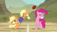 Applejack bucks the ball while Pinkie flinches S6E18