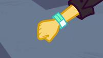 Festival bracelet is put on Sunset's wrist EGSBP