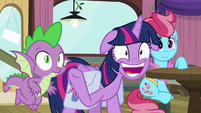 Twilight giving a wide grin and wave S9E16