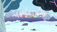 Breezie group flying over snowy field S4E16