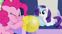 Pinkie blows a balloon while Rarity looks curiously EG2