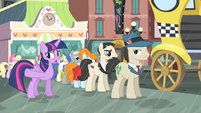 Twilight talking to a pony in line S4E08