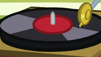 Close-up on spinning vinyl record S9E15