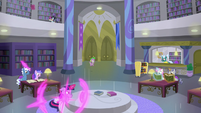 Twilight teleports beside library center table S9E5