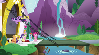 Twilight flying over her friends into Canterlot S9E1