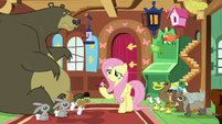 Fluttershy surrounded by her animal friends S7E5