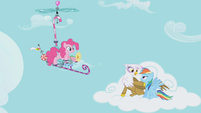 Pinkie Pie catches up to Rainbow Dash and Gilda with a flying contraption S1E05