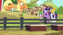 Applejack luring pigs with corn S6E10