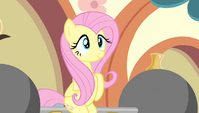 Fluttershy sitting on a barbell S4E24
