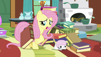 Fluttershy unburies Angel from book pile S7E5