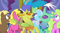 Discord appears behind the crowd S7E1