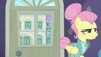 Fluttershy walking away from the door S8E4