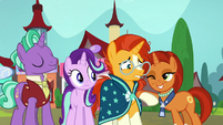Stellar Flare nudging Sunburst with her elbow S8E8