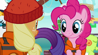 AJ and Pinkie watch Rarity board the boat S6E22