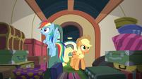 Applejack and Rainbow enter the luggage car S6E18