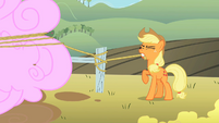 Applejack tying rope to a fence post S2E01