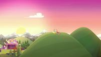 Sun rising over the music festival hill CYOE11b