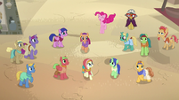 Pinkie Pie bounces through the crowd of villagers S7E18