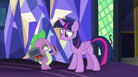 Spike holding a box of Twilight's quills S7E22