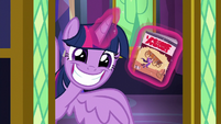 Twilight grins with Power Ponies comic S9E26