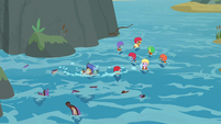 AJ, Dash, and students float in the stream S8E9