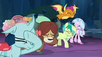 Young 5 shield themselves from falling rocks S9E3
