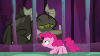 Pinkie Pie approaching a caged creature S8E25