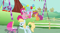 Pinkie Pie looks at a mare with her baby S5E19