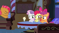 CMC at the table while Babs Seed dashes toward them S3E4