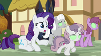 Rarity tries to snap Sweetie Belle out of it S9E2
