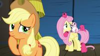 Applejack thinks as Fluttershy talks to Flying Prairinos S6E20