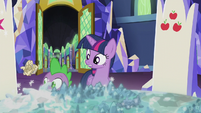 Crumpled scroll bounces past Twilight and Spike S5E25