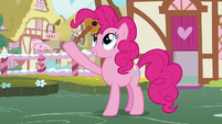 Pinkie Pie stuffs the guitar into her mane S7E9