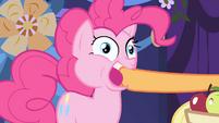 Applejack stuffs an apple into Pinkie's mouth S1E01